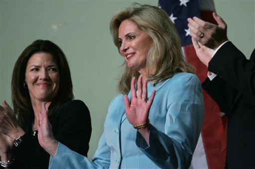 Ann Romney, center, wife of Massachusetts Gov. Mitt Romney, acknowledges applause as she is introduced by her husband during his State of the State address in the House chamber at the Statehouse, in Boston on Wednesday, Jan. 18, 2006. Debbie DiMasi, left, is the wife of Speaker of the House Sal DiMasi, D-Boston. (AP Photo/Steven Senne)